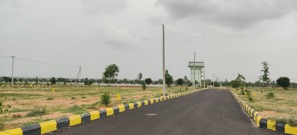 Open Plots in Sadashivpet hyderabad , hyderabad to mumbai highway facing layout in sadashivpet sangareddy dtcp approved gated community layout black top roads compound wall , entrance gate , park,